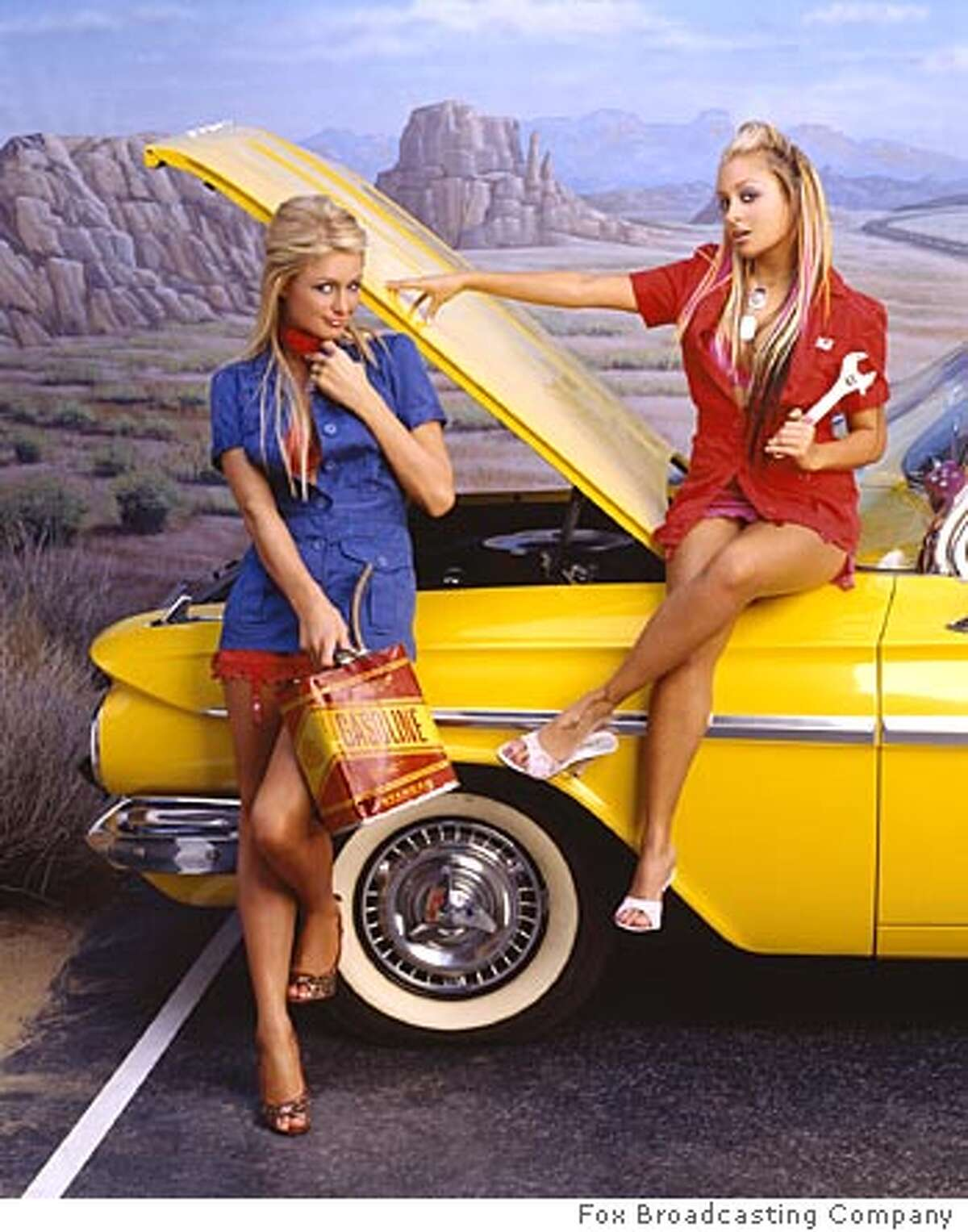 """GOODMAN16 THE SIMPLE LIFE 2: """"Celebutantes"""" and best friends Paris Hilton (L) and Nicole Richie (R) pack up their Louis Vuitton bags and embark in the ultimate road trip when THE SIMPLE LIFE 2 debuts later this year on FOX. � �2004 FOX BROADCASTING COMPANY. Ran on: 06-16-2004 Paris Hilton: One half of TVs Dumb and Dumber."""