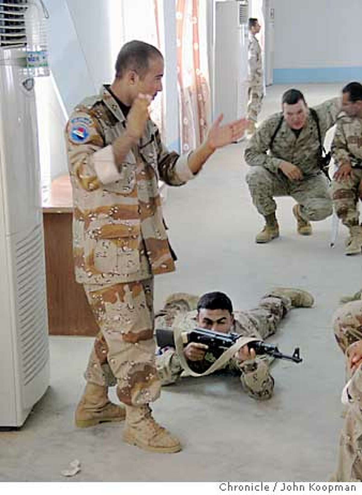 Marine Sgt. Bill Knipper conducts training in squad tactics with Iraqi commando recruits. Chronicle photo by John Koopman