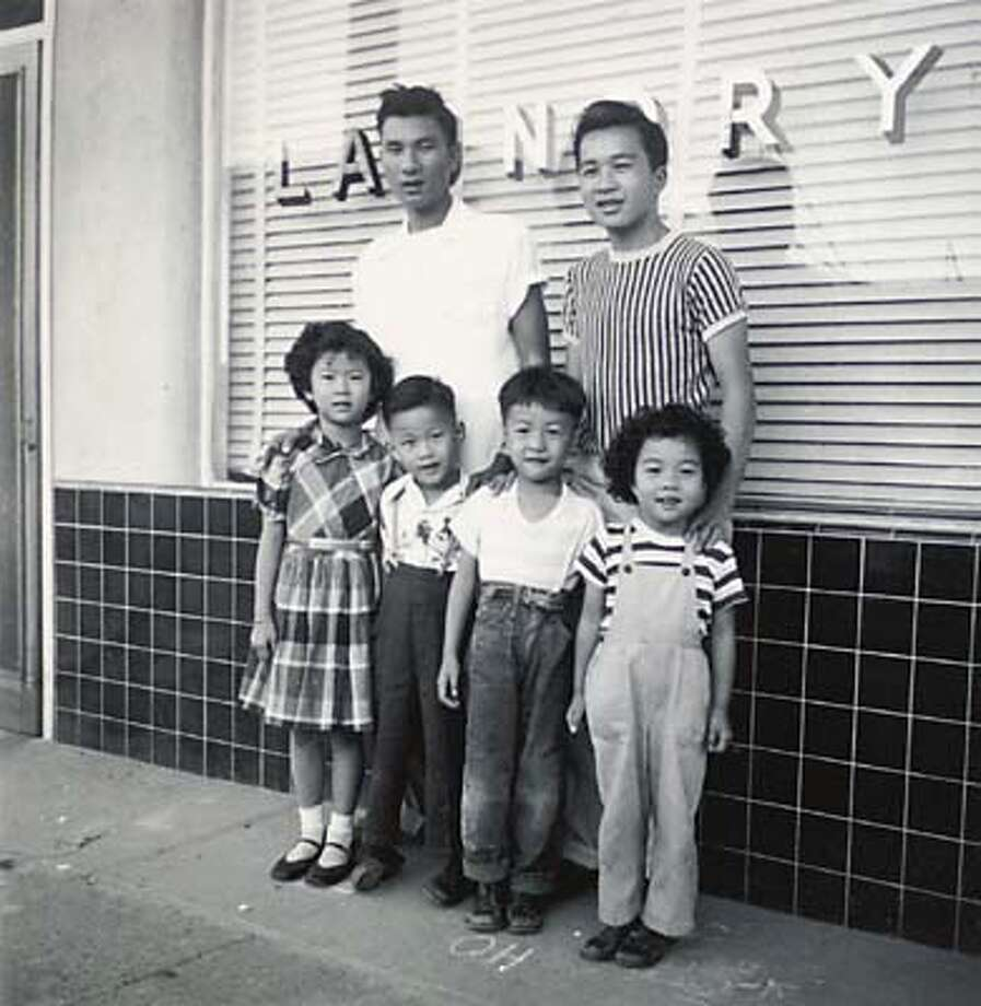 Copy photo from Thomas Hong when he worked in a laundry in his younger days. Tomas is standing in the upper right of the photo. The others are his brothers, sisters and cousins. Thomas Hong, partner in CEO Networking. Story about immigrant economic niches, and how later generations move on. As a child growing up in Benicia, Thomas Hong helped run his family's Chinese laundry. Now he is head of CEO Networking. Photo by Craig Lee/San Francisco Chronicle Photo: CRAIG LEE