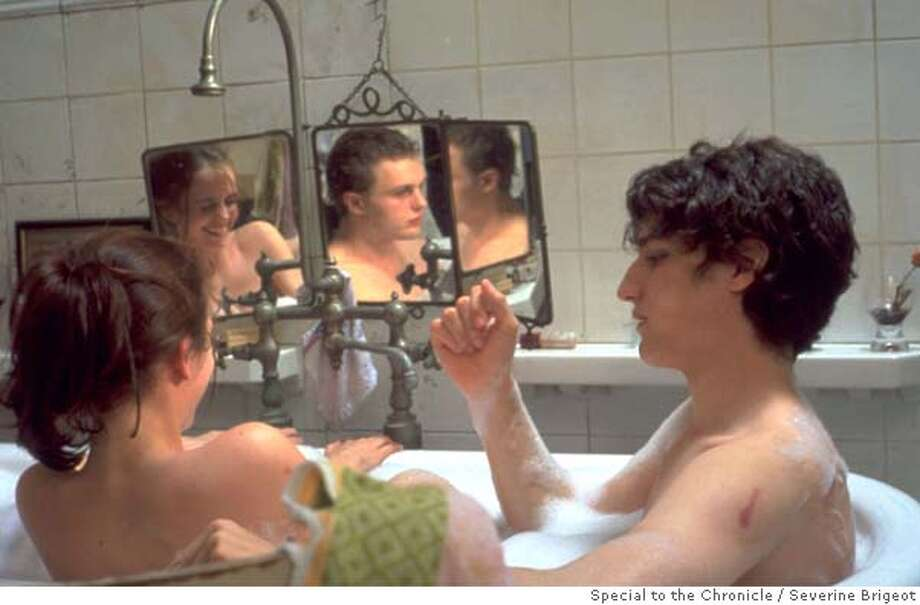 for preview04; Left to Right : Eva Green , Michael Pitt (reflection) and Louis Garrel in THE DREAMERS. Photo Credit: Severine Brigeot