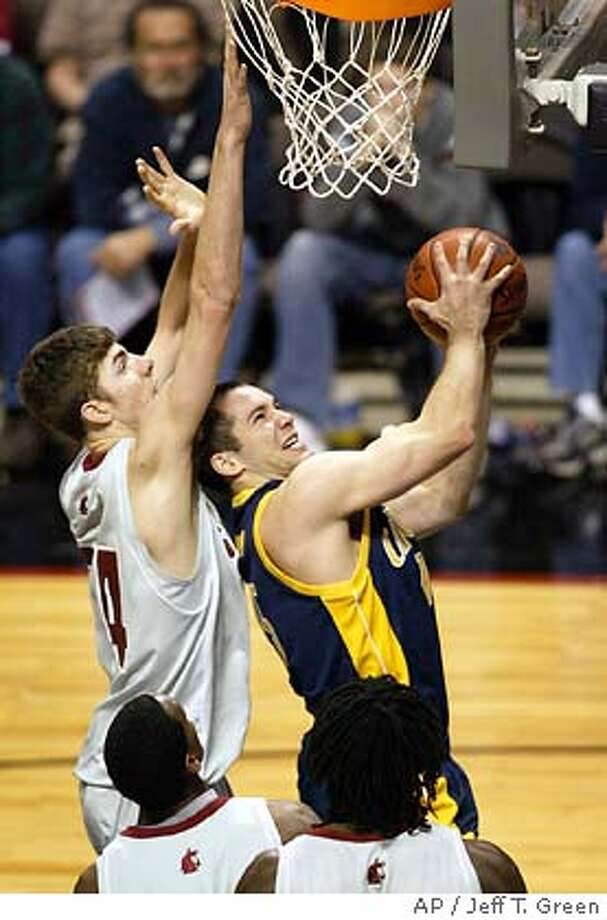 California's Richard Midgley, right, goes to the boards in the first half against Washington State's Robbie Cowgill, left, Thomas Kelati (11) and Jeff Varem (45) Sunday, Jan. 2, 2005, in Spokane, Wash. (AP Photo/Jeff T. Green) Photo: JEFF T. GREEN