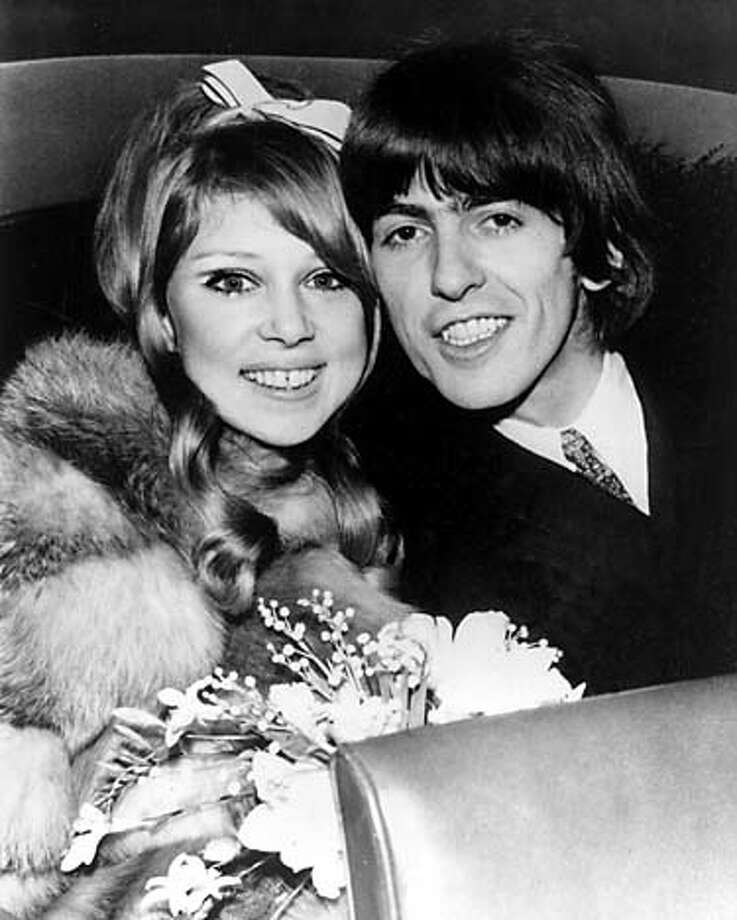 FILE--Newlyweds George Harrison and actress Patti Boyd pose in the back seat of a car after their marriage at the Epsom registery office outside London, England, in this Jan. 21, 1966, file photo. Harrison died Thursday Nov. 29, 2001, a longtime family friend said. He was 58. (AP Photo) A JAN. 21, 1966, FILE PHOTO