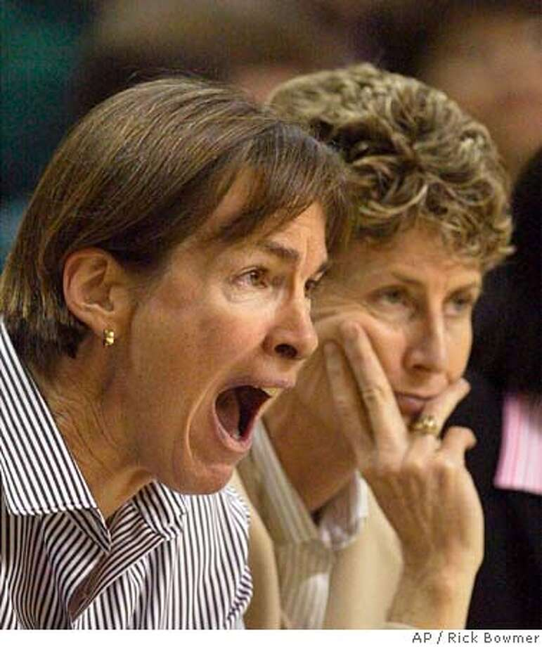 Stanford coach Tara VanDerveer, left, shouts while assistant coach Amy Tucker, right, looks on during the final minutes of their game with Oregon Wednesday, Dec. 29, 2004, at McArthur Court, in Eugene, Ore. Oregon defeated No. 5 Stanford 62-58. (AP Photo/Rick Bowmer) Photo: RICK BOWMER