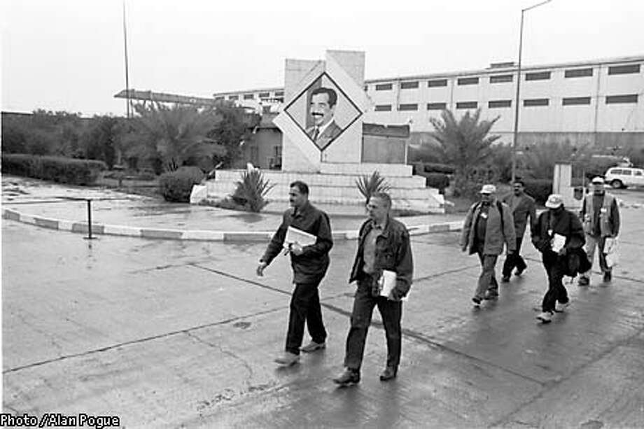 INSPECT30B-29DEC02-FN-HO --- U.N. inspectors and Iraqi officials tour the al-Nasr plant 30 miles from Baghdad, Iraq on Friday, December 28, 2002.  (PHOTO BY ALAN POGUE/SPECIAL TO THE CHRONICLE)