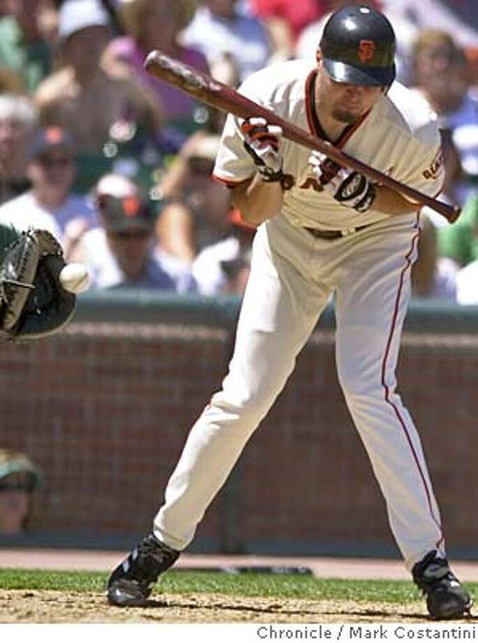 Photo taken on 9/11/99 in SAN FRANCISC0.  GIANTS BATTER(AND PITCHER) JASON SCHMIDT GETS HIT BY A PITCH IN THE 5TH INNING. THE GIANTS SUBSESEQUENTLY SCORED A GO AHEAD RUN IN THE INNING AS WELL AS AN ADDITTONAL RUN, PUTTING THEM UP 3-1 AT THAT POINT..  GIANTS V. ARIZONA AT SBC PARK.  Photo: Mark Costantini/SF Chronicle Photo: MARK COSTANTINI