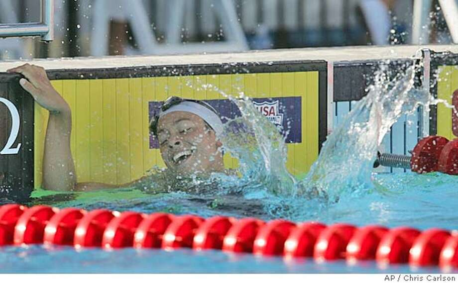 Dana Kirk reacts after winning the Women's 200 meter Butterfly at the U.S. Olympic swim trials in Long Beach, Calif., Sunday, July 11, 2004. Kirk finshed with a time of 2:08.86 (AP Photo/Chris Carlson) Photo: CHRIS CARLSON