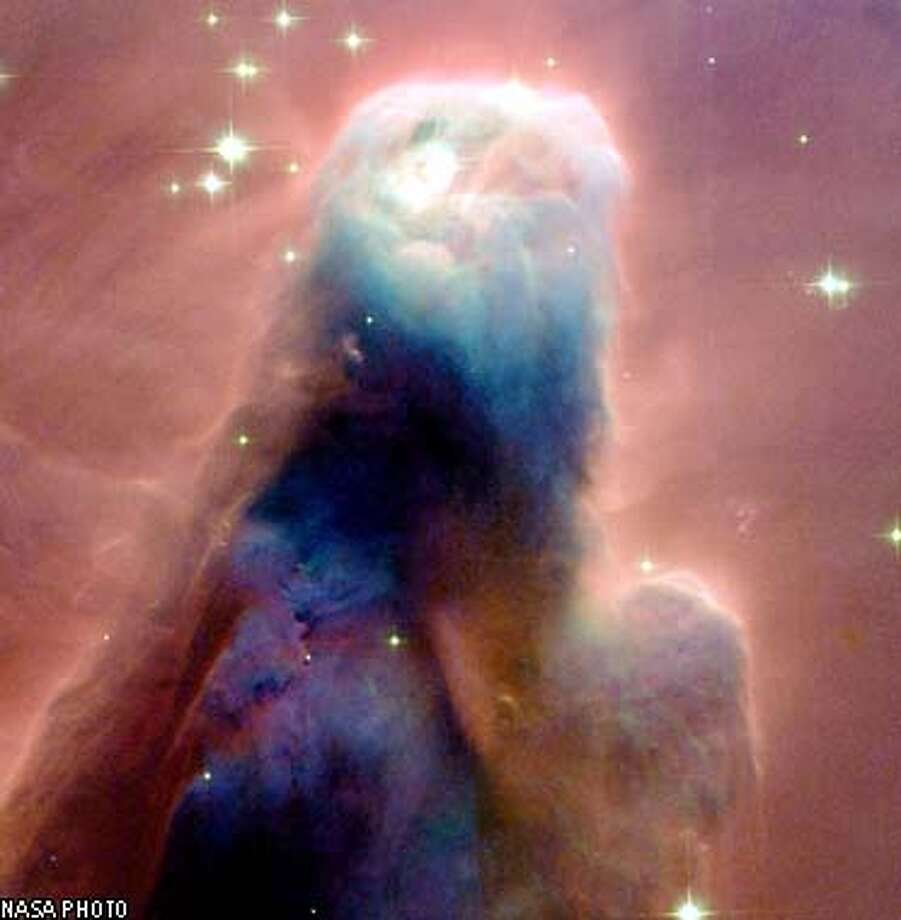"""THIS IS A HANDOUT IMAGE. PLEASE VERIFY RIGHTS. The Hubble telescope imaged the """"Cone Nebula,"""" a craggy-looking mountaintop of cold gas and dust that is a cousin to Hubble's iconic """"pillars of creation"""" in the Eagle Nebula, photographed in 1995.  NASA PHOTO Photo: NASA"""