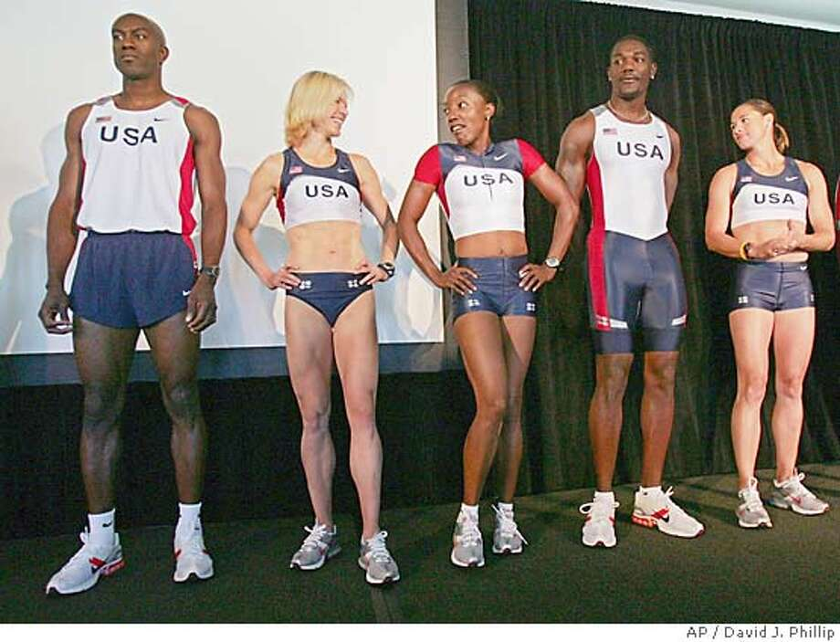U.S.A. Track and Field athletes, from left, Allen Johnson, Jen Toomey, Inger Miller, Justin Gatlin and Stacy Dragila show off the 2004 federation uniforms which will debut at the Olympic games in Athens this summer during a news conference Tuesday, July 13, 2004, in Sacramento. (AP Photo/David J. Phillip) Photo: DAVID J. PHILLIP