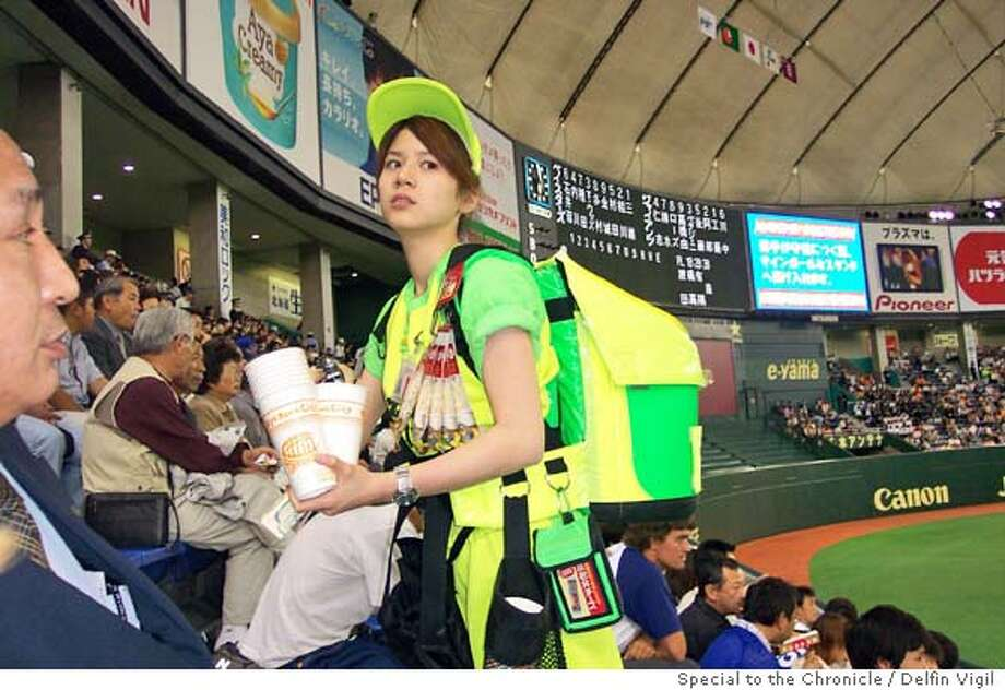 TRAVEL TOKYO -- You can still get beer from vendors in the stands at the Tokyo Dome for Yomiuri Giants games. Credit: Delfin Vigil/The Chronicle Ran on: 07-11-2004  Beer vendors in the Yomiuri Giants' Tokyo Dome bleachers don't bellow like their counterparts at SBC Park do -- neon-bright uniforms do the shouting for them. Ran on: 07-11-2004 Photo: Delfin Vigil