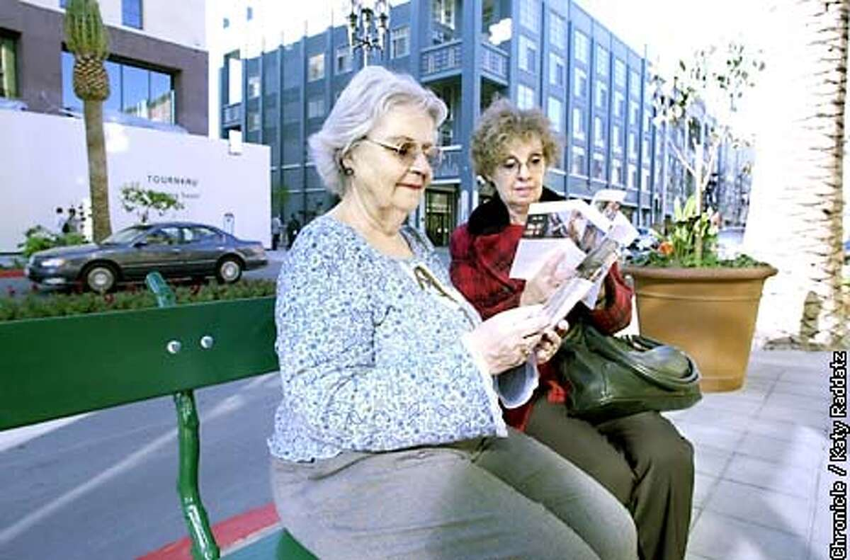 PHOTO BY KATY RADDATZ--THE CHRONICLE Santana Row in San Jose. Three blocks of shops with apartments above. A real place to live, or instant urbanity, or theme park? Women reading guide to Santana Row are L to R Alberta Parker and Rita Crowley from San Jose.
