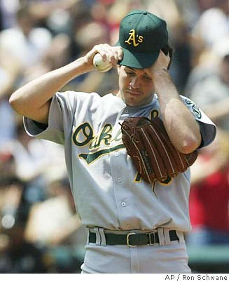 Oakland Athletics pitcher Barry Zito reacts after giving up a solo homerun to Cleveland Indians' Coco Crisp in the fourth inning Sunday, July 11, 2004, in Cleveland. Zito picked up the loss as the Indians defeated the Athletics 4-1. (AP Photo/Ron Schwane) Photo: RON SCHWANE