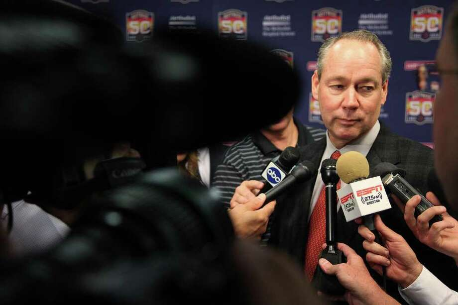 Astros Owner & Chairman Jim Crane addresses the media after he announces the new fan-friendly initiatives for the 2012 baseball season at Minute Maid Park on Monday, Jan. 23, 2012, in Houston.  Reduction in ticket seating and rebates for season ticket holders are part of the new fan-friendly initiatives. Fans will be able to bring food and sealed water bottles into the park as long as it's transported in a small clear (see-through) plastic bag. Astros have expanded the $5 beer special to include every permanent concession stand and bar where domestic beer is sold.  ( Mayra Beltran / Houston Chronicle ) Photo: Mayra Beltran / © 2012 Houston Chronicle
