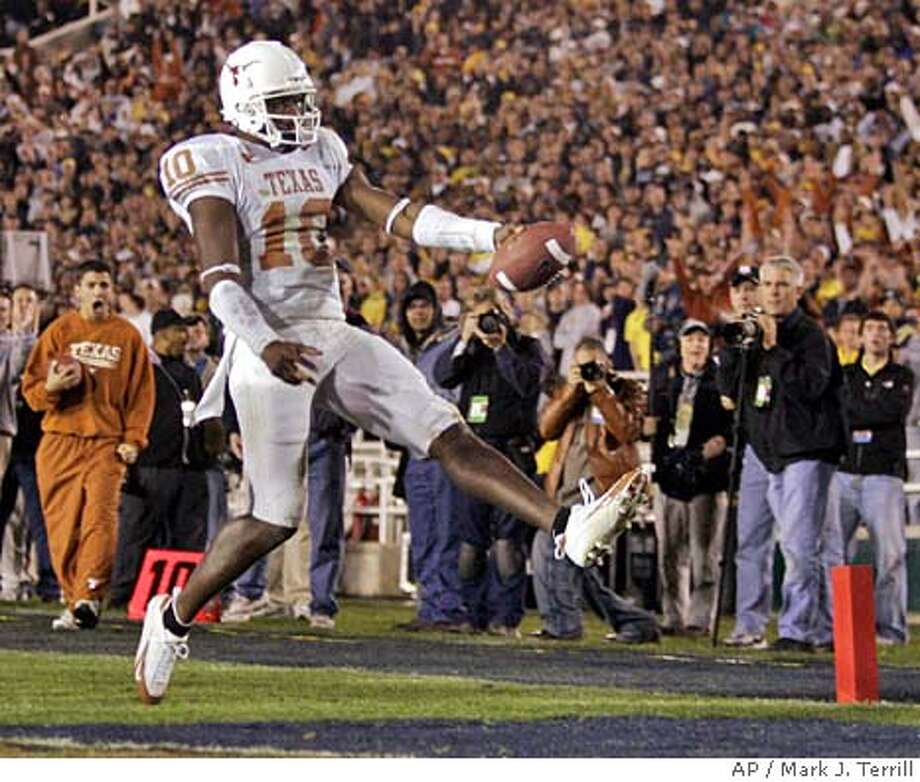 Texas quarterback Vince Young (10) crosses into the end zone for a 23-yard touchdown during the fourth quarte rof the Rose Bowl against Michigan in Pasadena, Calif., Saturday, Jan. 1, 2005. (AP Photo/Mark J. Terrill) Photo: MARK J. TERRILL