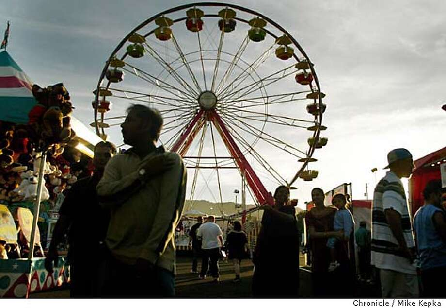 Visiting the Alameda County fair in Pleasanton is a classic american way to spend a summer evening.  MIKE KEPKA/The Chronicle Photo: MIKE KEPKA