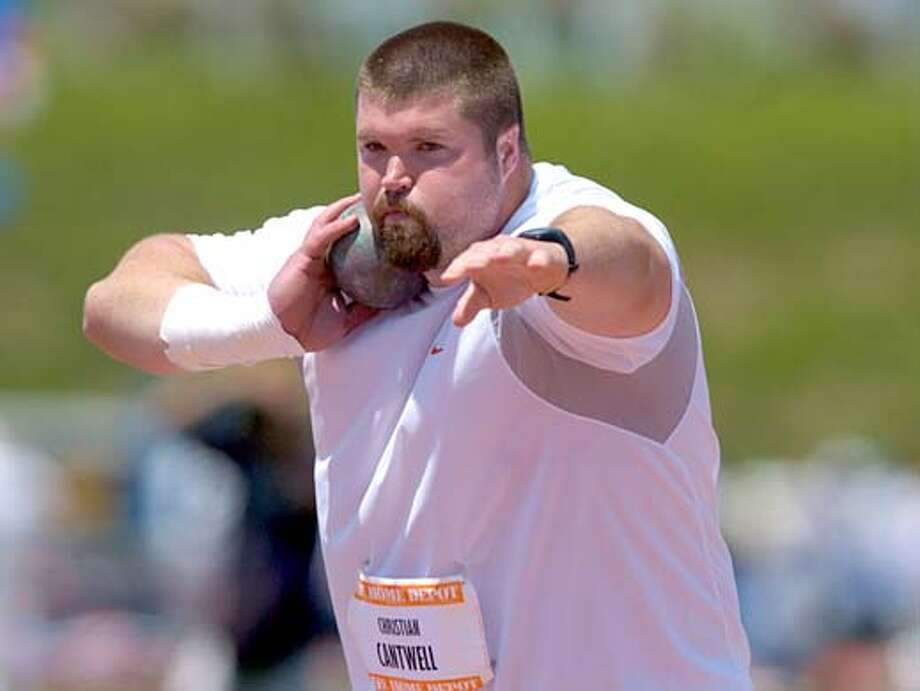 Christian won the men's shot put at 73 feet, 4 inches (22.35m) in the Home Depot Track & Field Invitational at the Home Depot Center on Saturday, May 22, 2004. Photo: Kirby Lee