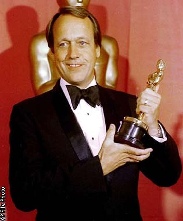 "** FILE ** Director George Roy Hill holds his Oscar for Best Director for his film ""The Sting"" at the Academy Awards in this April 3, 1974 file photo in Los Angeles. Hill, the independent-minded former Marine pilot who directed Paul Newman and Robert Redford in both ""Butch Cassidy and the Sundance Kid'' and ""The Sting,'' died Friday, Dec. 27, 2002. He was 81. (AP Photo/File)"