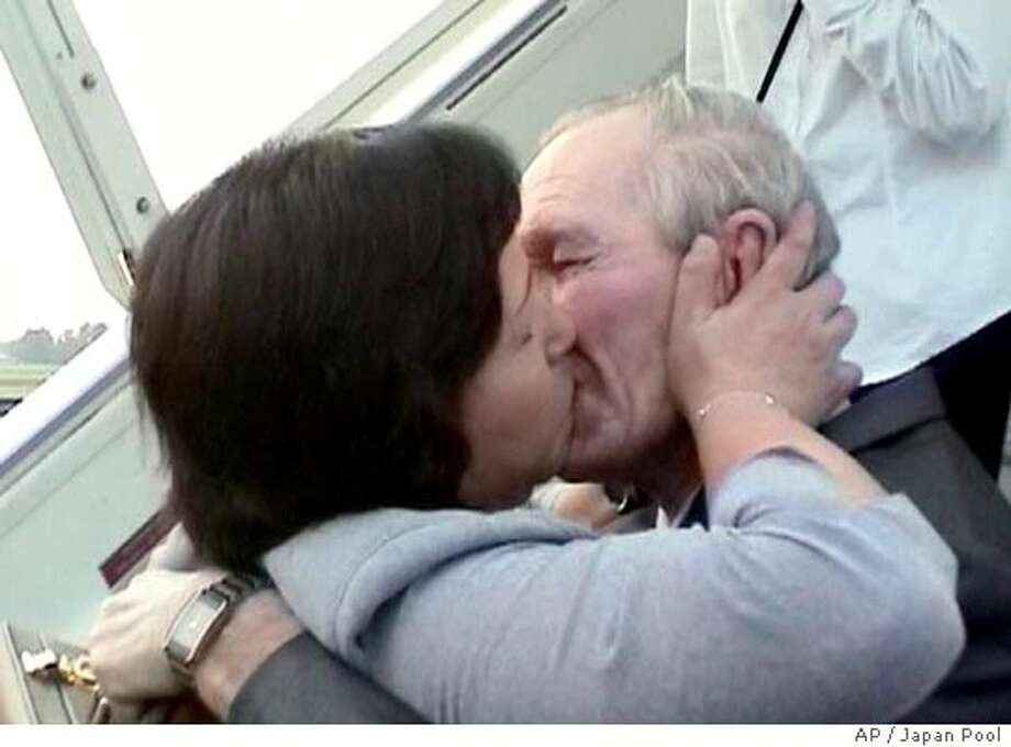 American Charles Robert Jenkins and his wife, former Japanese abductee Hitomi Soga, kiss upon his arrival at Sukarno-Hatta International Airport in Jakarta, Indonesia, from Pyongyang, North Korea, Friday, July 9, 2004, in this video image. Jenkins who allegedly deserted his Army unit 40 years ago to defect to North Korea arrived in Indonesia with his two daughters for a long-awaited reunion with Soga. (AP Photo/Japan Pool) ** JAPAN OUT ** Ran on: 07-10-2004  Charles Jenkins, an ex-U.S. soldier, and his wife, Hitomi Soga, a former Japanese abductee, kiss upon his arrival in Indonesia.
