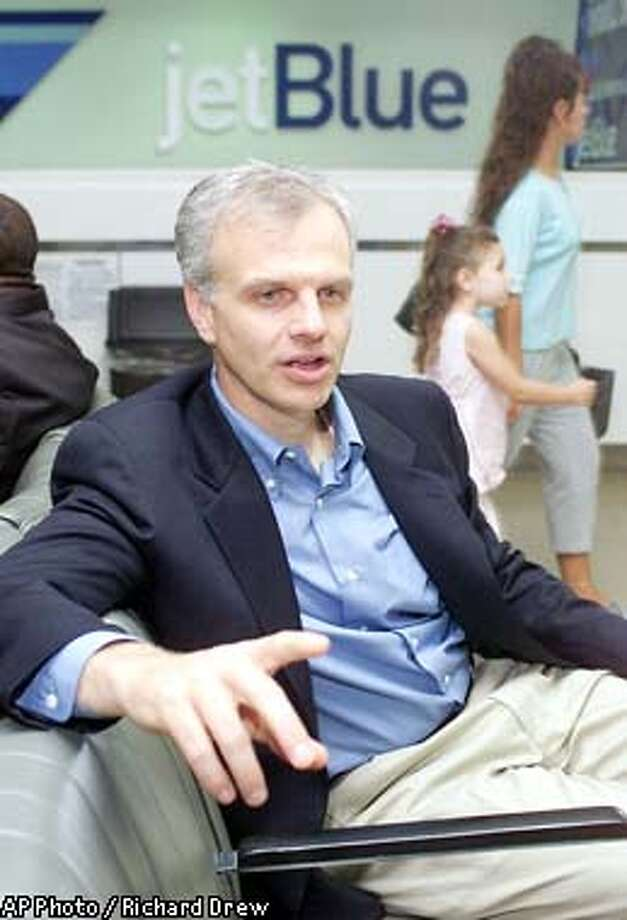 David Neeleman, founder and CEO of Airways, responds to a question during an interview at New York's John F. Kennedy International Airport, Thursday July 26, 2001. While low fares are a top priority at jet Blue, Neeleman also wants and airline that is enjoyable to fly. (AP Photo/Richard Drew) Photo: RICHARD DREW