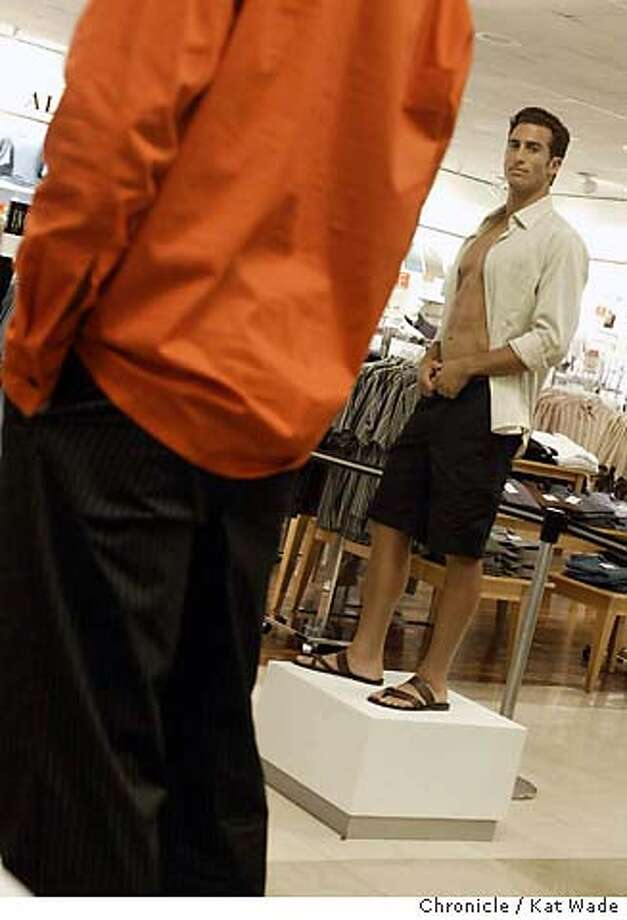 Models pose as manequins on pedestals for Macy's fashion show for it's fall menswear I.N.C. line on 6/30/04 in {{city} at the Macy's for Men store. Kat Wade/The Chronicle Photo: Kat Wade