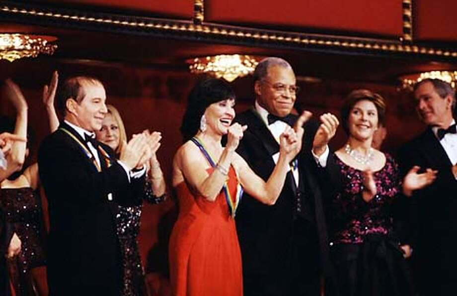 caption: Year 2002 Honorees Paul Simon (far left), Chita Rivera (second from left) and James Earl Jones (center), enjoy the festivities - along with President and Mrs. George W. Bush - at THE 25th ANNUAL THE KENNEDY CENTER HONORS: A CELEBRATION OF THE PERFORMING ARTS, to be broadcast Friday, Dec. 27 (9:00-11:00 PM, ET/PT) on the CBS Television Network.  copyright: Photo: Diana Walker/CBS  �2002 CBS Worldwide Inc. All Rights Reserved  HANDOUT PHOTO Photo: HANDOUT