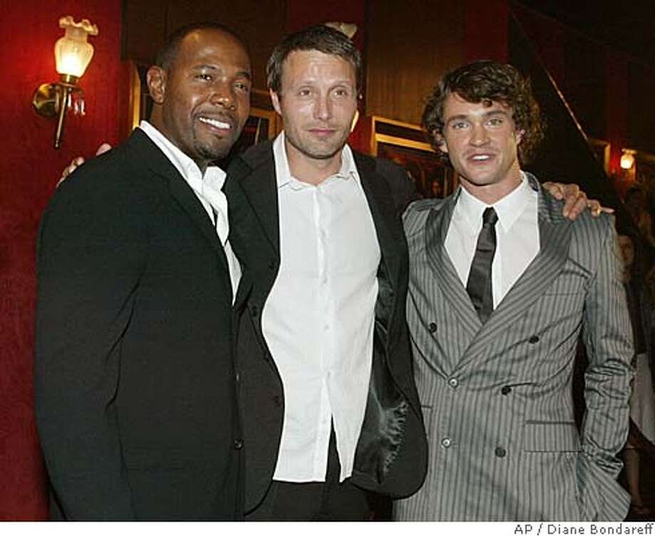 "Director Antoine Fuqua, left, and actors Mads Mikkelson, center and Hugh Dancy arrive at the world premiere of ""King Arthur,"" Monday, June 28, 2004, in New York. (AP Photo/Diane Bondareff) Ran on: 07-11-2004  &quo;King Arthur&quo; director Antoine Fuqua (left) with actors Mads Mikkelson and Hugh Dancy at the New York premiere. Photo: DIANE BONDAREFF"