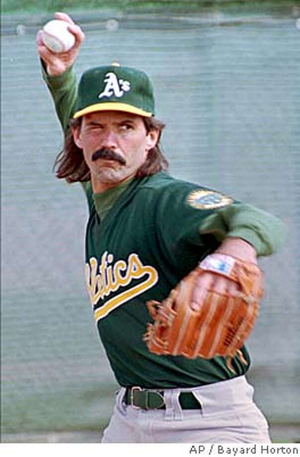 Oakland Athletics pitcher Dennis Eckersley throws during practice at the first day of spring training in Scottsdale, Ariz., Saturday, Feb. 20, 1994. Eckersley only threw a few pitches before stopping and complaining of a sore neck. (AP Photo/Bayard Horton) ALSO RAN 10/20/95, 2/14/96 04/16/1999 CAT Photo: BAYARD HORTON