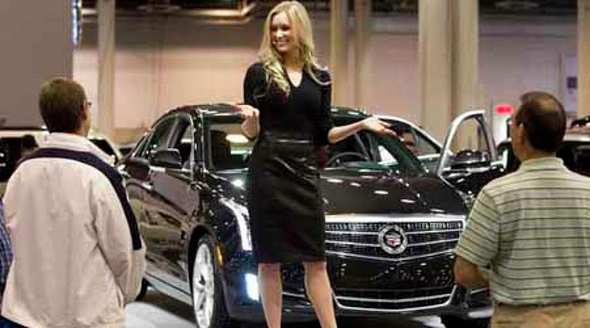 Erin W. talks about the Cadillac ATS at the Houston Auto Show Wednesday, Jan. 25, 2012, in Houston.