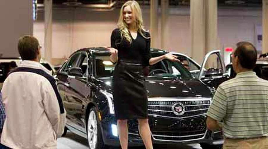 Erin W. talks about the Cadillac ATS at the Houston Auto Show Wednesday, Jan. 25, 2012, in Houston. Photo: Brett Coomer, Houston Chronicle / © 2012 Houston Chronicle