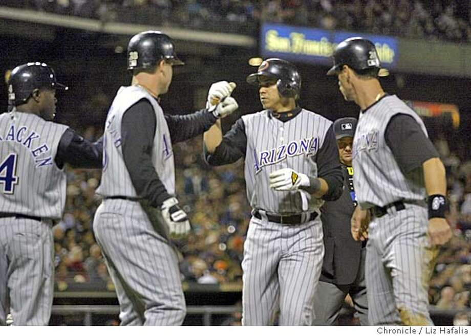 Giants vs. Diamondbacks at SBC park. Alex Cintron hits a home run with two men on base bringing 3 runs in the 7th inning. Shot on 1/7/01 in San Francisco. LIZ HAFALIA / The Chronicle Photo: LIZ HAFALIA