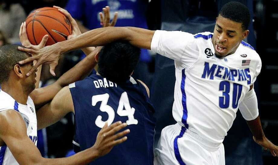 Memphis' D.J. Stephens, right, collides with Rice's Omar Oraby, middle, and Memphis' Wesley Witherspoon, left, during the first half of an NCAA college basketball game Wednesday, Jan. 25, 2012, in Memphis, Tenn. (AP Photo/The Commercial Appeal, Mark Weber) Photo: Mark Weber / The Commercial Appeal