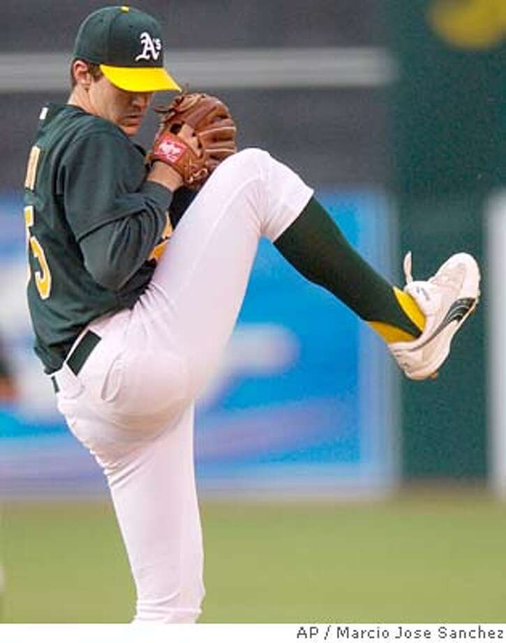 Oakland Athletics starter Barry Zito pitches to the Anaheim Angels in the first inning on Wednesday, June 30, 2004, in Oakland, Calif. (AP Photo/Marcio Jose Sanchez) Photo: MARCIO JOSE SANCHEZ