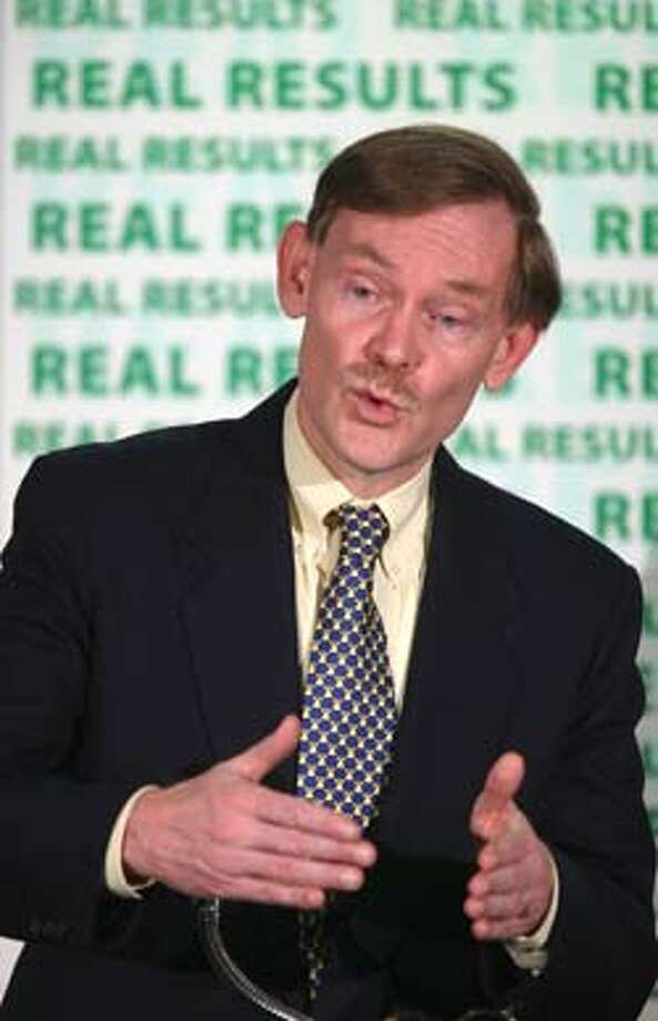 U.S. Trade Representative Robert Zoellick gestures during a news conference in Washington Thursday, July 8, 2004 to announce the Bush had resolved its dispute with China in which the U.S. contended the Chinese were using their tax code to discriminate against American semiconductor manufacturers. (AP Photo/Hans Ericsson)  � Trade Representive Robert Zoellick told a news conference that China had agreed not to certify any new semiconductor products or manufacturers for tax refunds. By next April, China would drop the tax preferences it now provides semiconductor makers. Photo: HANS ERICSSON
