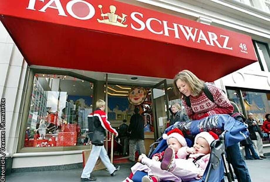 FAO25A-C-24DEC02-BU-DF  FAO Schwarz toy store at Union Square may be closing. Leah Dines from Scottsdale, Arizona pushes a stroller with her identical twin daughters, ( l to r) Madeline and TaylorA-C-24DEC02-BU-DF  FAO Schwarz toy store at Union Square may be closing. Leah Dines from Scottsdale, Arizona pushes a stroller with her identical twin daughters, ( l to r) Madeline and Taylor,