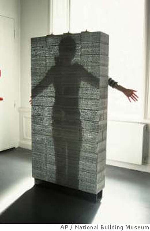 """Prototype wall of LiTraCon, a product. It used to be only Superman could see through concrete walls, but an exhibit at Washington's National Building Museum shows mere mortals can do it too. Called """"Liquid Stone,"""" the show features variations of , a newfangled version of the old construction standby that offers architects and builders a combination of aesthetics and practicality. (AP Photo/National Building Museum)"""