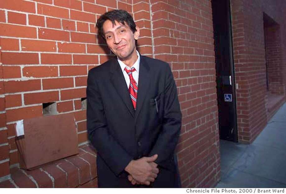 BBC07-06NOV00-PZ-BW--Reza Eslaminia, the final defendant in the infamous Billionaire Boys Club murder case, had to smile after the case against him was thrown out Monday. By Brant Ward/Chronicle. ALSO RAN 11/8/2000. CAT Photo: BRANT WARD