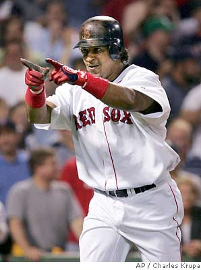 Boston Red Sox's Manny Ramirez points into the dugout after his seventh inning home run against the Oakland Athletics at Fenway Park in Boston, Wednesday July 7, 2004. (AP Photo/Charles Krupa) Photo: CHARLES KRUPA