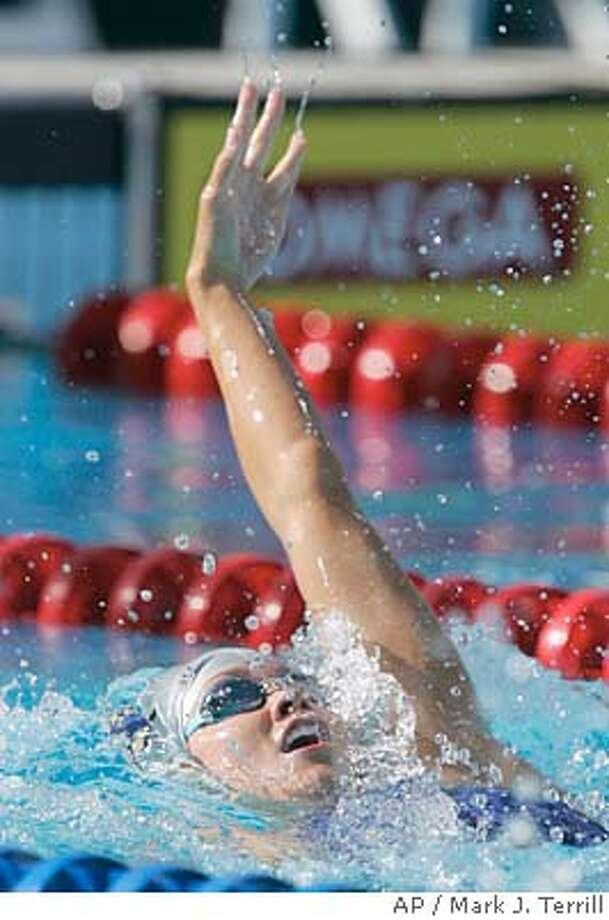 Amanda Beard swims toward the finish during the Women's 100 Meter Backstroke final at the U.S. Olympic in Long Beach, Calif., Friday, July 9, 2004. Beard won the race with a time of 1:07.64. (AP Photo/Mark J. Terrill) Photo: MARK J. TERRILL