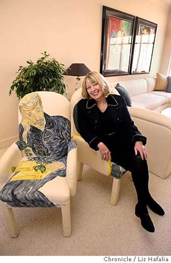 "Sherri Ferris--founder of Protocol Professionals Inc. heading an international relations consulting team that specializes in protocal, etiquette training and special event production--sitting with Van Gogh's ""Dr. Gache"" in her Russian Hill condo. Her contemporary upholstered chairs has been hand-painted by artist Susan Mauntel with characters from well-known works by Vincent Van Gogh, Toulouse-Lautrec and Henri Matisse. Shot on 6/15/04 in San Francisco. LIZ HAFALIA / The Chronicle Photo: LIZ HAFALIA"
