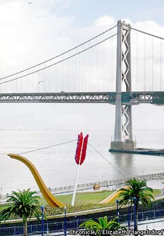 "the sculpture ""Cupid's Span"" on the embarcadero, with the Bay Bridge in the background.  Chronicle Photo by Liz Mangelsdorf. Photo: Liz Mangelsdorf"