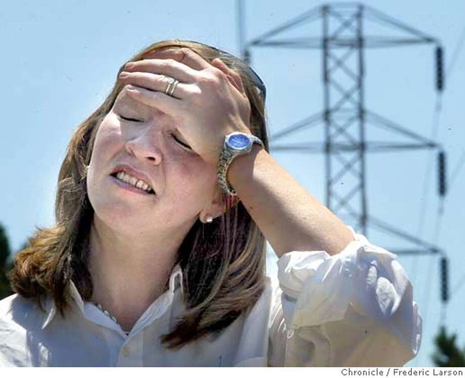 ; Lara Lighthouse, a resident and also with the 280 (HWY) Corridor Concerned Citizens trying to stop the powerlines from their neighborhood. The PUC is set to decide on an alignment for a major PG&E power transmission line snaking through the peninsula. The Jefferson-Martin Project will bring power to residents in SF and San mateo County. But some residents have raised objections to the plan and want the proposed lines moved out of their neighborhoods because they fear health risks from electrical magnetic fields. The 280 CCC have tried to get the southern portion of hte line moved to the west away from homes along Skyline Boulevard  7/2/04  San Francisco Chronicle Frederic Larson Photo: Frederic Larson