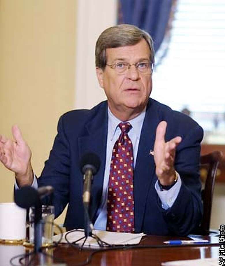 "** FILE ** Senate Minority Leader Trent Lott, R- Miss., meets reporters on Capitol Hill, in this Oct. 15, 2002 file photo. Lott ignited a controversy with remarks at an event marking Sen. Strom Thurmond's 100th birthday, Dec. 5, 2002. Lott said Mississippians were proud to have voted for Thurmond in 1948. ""And if the rest of the country had followed our lead, we wouldn't have had all these problems over all these years, either."" (AP Photo/Terry Ashe, File) Photo: TERRY ASHE"