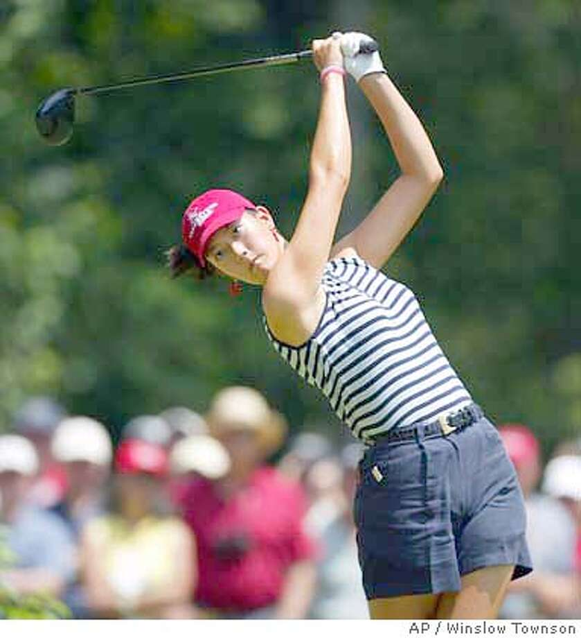 Michelle Wie tees off on the second hole during the final round of the U.S. Women's Open at The Orchards Golf Club in South Hadley, Ma. Sunday, July 4, 2004. Wie finished as the low amateur, nine shots behind winner Meg Mallon. (AP Photo/Winslow Townson) Photo: WINSLOW TOWNSON