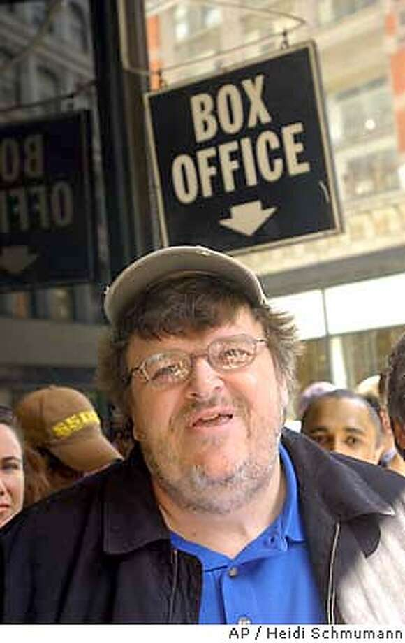 "Director Michael Moore speaks during a news conference about his film ""Fahrenheit 9/11,"" Sunday, June 27, 2004, in New York.(AP Photo/Heidi Schmumann) A JUNE 27 2004 PHOTO Photo: HEIDI SCHUMANN"