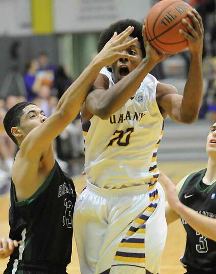 Gerardo Suero of UAlbany drives to the basket during a basketball game against Binghamton at the SEF