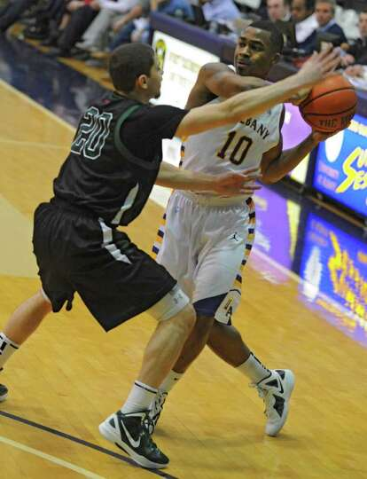 Mike Black of UAlbany is guard by Jimmy Gray of Binghamton at the SEFCU Arena Wednesday, Dec. 25, 20