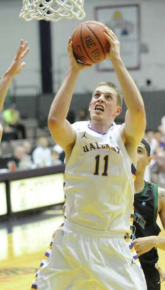Luke Devlin of UAlbany drives to the basket during a basketball game against Binghamton at the SEFCU