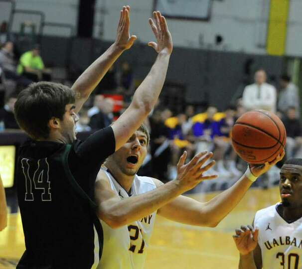 Blake Metcalf of UAlbany tries to get around Ben Dickenson of Binghamton during a basketball game at