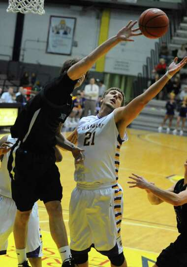 Blake Metcalf of UAlbany tries to get a rebound against Binghamton during a basketball game at the S