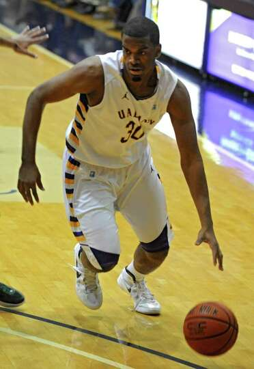 Jayson Guerrier of UAlbany dribbles the ball during a basketball game against Binghamton at the SEFC
