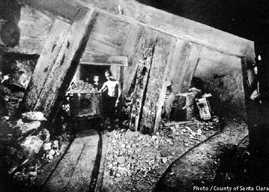 ?MERCURYi-C-06DEC02-MT-HO  Ore cart and miners in Randol Shaft at the Almaden Quicksilver County Park. (circa 1880's)  The SF Bay's single biggest source of toxic mercury comes from the Almaden Quicksilver County Park which was once the site of extensive quicksilver (mercury) mining. Sediments that contain mercury have deposited in some of the local reservoirs and streams and has polluted the bay. After the ubiquitous PCBs, mercury is the second worst bay contaminant The park is the site of over 135 years of mining activities and former home to more than 1,800 miners and their families.  PHOTO COURTESY OF THE COUNTY OF SANTA CLARA